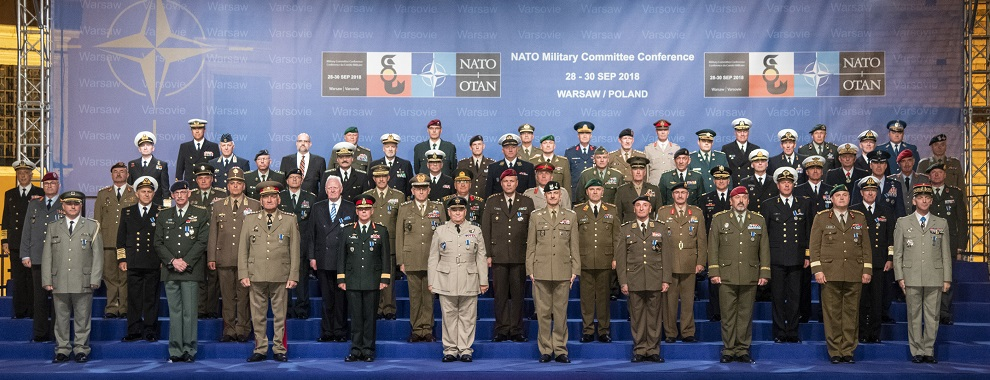 Chiefs of defense from 29 countries pose for a photo during the official welcome ceremony before the start of the North Atlantic Treaty Organization (NATO) Military Committee Conference in Warsaw, Poland Sept. 28, 2018. (DOD photo by Navy Petty Officer 1st Class Dominique A. Pineiro)