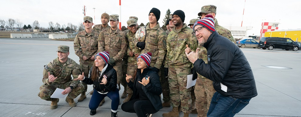 Service members at Mihail Kognalniceanu Air Base, Romania, greet USO Talent as they arrive as part of the Chairman's USO New Year's Tour 2020, Jan. 6, 2020. Vice Chairman of the Joint Chiefs of Staff Gen. John E. Hyten and Senior Enlisted Advisor to the Chairman Ramon