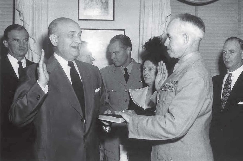 Defense Secretary Louis A. Johnson swears in General of the Army Omar N. Bradley as the nation's first chairman of the Joint Chiefs of Staff, Aug. 16, 1949. DoD photo
